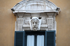 A head for eternity (ejhrap) Tags: italy rome roma window statue italia head decoration carving ornate topper decorated