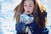 the first fall of snow is not only an event, it is a magical event (AmyJanelle) Tags: blue winter snow girl focus blow curlyhair bluecoat