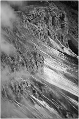 Slopes (PascallacsaP) Tags: bw france clouds rocks slopes hautesalpes afsdxvrzoomnikkor18200mmf3556gifed picdebure silverefexpro2