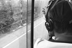 Behind the window! (Abdulaziz Al-furaydi) Tags: boy sky music white man black reflection bus guy monochrome rain canon sad song vietnam raining headphone 550 2470mm 2470      550d   canon550            canon550d 550 550 550 2470