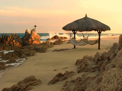 Lands End (Ani Carrington) Tags: ocean pink sky bird beach water mxico mexico sand waves explore hammock palapa bajacalifornia baja bajacaliforniasur sanjosdelcabo loscabos gulfofcalifornia golfodecalifornia