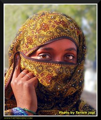 Veiled (Tanwir Jogi) Tags: travel pakistan red girl beautiful yellow trekking trek eyes veiled veil nomad pakistani traveling tours lahore nomads treks jogi beautifulpakistan trekkinginpakistan tanwir travelinginpakistan thetrekkerz tourisminpakistan tanwirjogi wwwthetrekkerzcom
