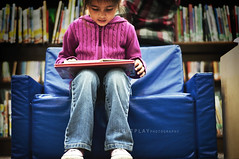 A Child Reading (LIGHTPLAY.) Tags: blue baby cute girl smart youth children reading chair little library young adorable books learning publiclibrary younggirl youngchild