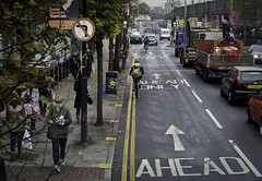 Aerial View- Cambridge Heath (Sven Loach) Tags: road street city uk autumn trees england urban signs bus london cars leaves ahead canon cyclists hipsters view britain pavement streetphotography bikes bicycles pedestrians arrows vans rucksack walkers londonstreets lanes eastlondon yellowstripes g12 traffiic towerhamlets cambridgeheath