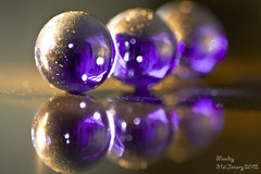 Three of a kind (k4wea) Tags: 3 reflection pits three purple bokeh circles sparkle marbles themed torchlight alphabetchallenge explored cisfor 31366 t189 52weekproject dailyishphoto odc2 highestposition67 ourdailychallenge t189522012week5
