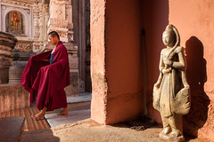 Monk, Bodhgaya (Marji Lang Photography) Tags: voyage travel pink light shadow red india man colors statue wall composition contrast walking asian religious rouge temple colorful asia shadows walk lumire couleurs buddha buddhist indian religion sunny monk buddhism bouddha ombre holy frame barefoot pilgrimage bodhi bouddhisme bihar bodhgaya mahabodhi travelphotography moine bodhitree bouddhiste ef247028l indiansubcontinent mahabodhitemple  canoneos5dmarkii bhrat travelanddocumentaryphotography  marjilang mahabodhimahaviharatemple