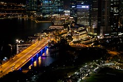 The Fullerton hotel with CBD and Singapore river at night (UweBKK ( 77 on )) Tags: city bridge light urban night river island hotel evening singapore view nocturnal darkness shot nightshot district sony central business cbd alpha dslr fullerton 77 merlion
