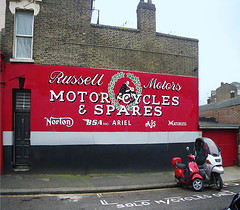 Russell Motors (Kombizz) Tags: poster billboard ajs bsa matchless 3517 narrowdoor bsam20 russellmotors kombizz redbillboard solomotorcycleparking doora127