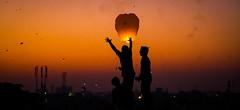 Flying Lantern (Morten Falch Sortland) Tags: old sunset two people india festival fun town flying horizon january lantern oldtown baroda kitefestival gujarat vadodara photomortenfalchsortland lanterntwo peoplefunsunsetjanuarybarodaold
