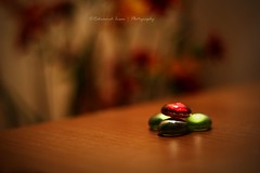 Red and green pebbles! (   Rehnumah Insan   ) Tags: red stilllife color macro green contrast canon vintage 50mm wooden dof artistic bokeh smooth indoor pebbles depthoffield dslr vignette silky 50mm18 canon600d