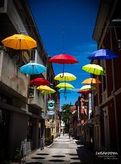 Umbrella in the sky (crearoom.ch) Tags: street city summer color umbrella croatia bluesky hr novigrad kroatien regenschirm faben zadarskaupanija crearoom