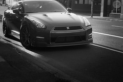Black GTR sunlit (pillarsoflight) Tags: auto blackandwhite bw white black monochrome beauty car oregon portland 50mm prime grey aperture nikon nissan bokeh sidewalk adobe beast pdx desaturated 10th pnw coupe throwback gtr lightroom d40