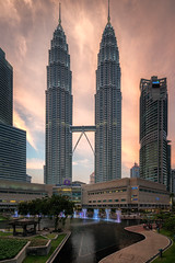 Petronas Twin Towers (CreArtPhoto.ro) Tags: sunset orange building water fountain yellow clouds square cityscape petronas towers twintowers kualalumpur nori apus cer petronasmalayesia