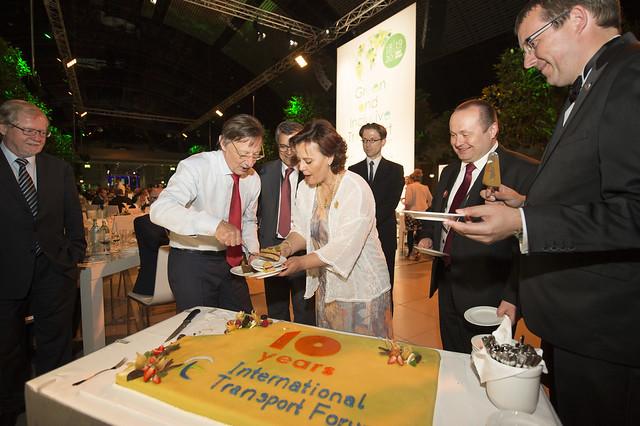Alain Flausch serves some cake