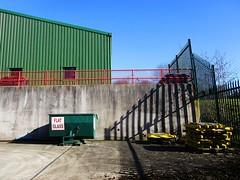 Recycling centre (Eire's Gorgeous Golden Gorse representative) Tags: ireland shadow irish wall yard fence cork bin recycling kanturk hff hww fencefriday canonixus170