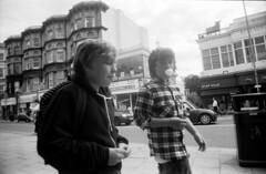 (Pete Boyd) Tags: street uk england people blackandwhite bw film 35mm brighton candid streetphotography bubblegum unposed spontaneous pentaxmx kodaktrix400 insouciance filmroll1 prinzflex23mmf35lens