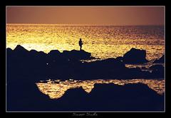 Fisherman (smeet_sinha) Tags: lighting sunset sky orange india seascape reflection silhouette yellow clouds canon gold lights golden landscapes rocks bombay mumbai landsacpe arabiansea canon1855mm gorai smeet goraibeach canon450d