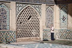 Lone prayer (momentaryawe.com) Tags: old history iran patterns muslim islam prayer religion pray middleeast mosque historic walls esfahan islamic d300s catalinmarin momentaryawecom