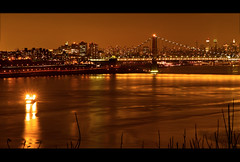 December Lights, New York City (SunnyDazzled) Tags: nyc newyorkcity longexposure skyline night reflections river gold lights golden cityscape skyscrapers manhattan hudson barge gwb georgewashingtonbridge