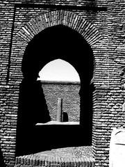 Malaga castle arch stone Spain andalucia (Broo_am (Andy B)) Tags: lighting street door city light white black luz statue del buildings la spain arch shadows floor dom bricks pillar sunny sombra medieval arabic ruina moors arco ladrillos castillo  islamic iphone castile    islmico      iphonegraphy  iphoneography