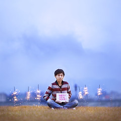 Happy New Year! (brandonhuang) Tags: new light boy portrait sky cloud white grass clouds self canon happy fire person dof bokeh year sparklers f2 sparkler sparks spark 2012 135mm ipad 500d f2l brandonhuang