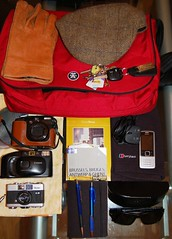 In my bag (03.01.12) (Mark Russell123) Tags: sunglasses mobile bag notebook keys books gloves cap cameras crumpler buff pens charger