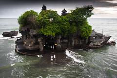 wading (Josh Corke) Tags: ocean sea bali cloud water rock clouds indonesia island temple rocks cloudy lot hindu tanahlot tanah