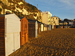 Beach Huts (eyekapics) Tags: uk blue red sea england orange sun beach water sunrise europe unitedkingdom tide broadstairs