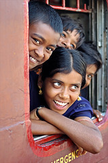 WINDOW OF JOY (Apratim Saha) Tags: family red india man color window train nikon funny child indian rail railway laugh westbengal indianrailway apratim apratimsaha