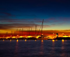 Yachts at dawn (Steve-h) Tags: longexposure blue red orange sun nature yellow sunrise canon reflections lens gold dawn lights pier spain control release tripod wideangle andalucia shutter wireless remote costadelsol yachts masts yachtharbour risingsun marbella darkblue lightweight velbon mirrorlockup steveh 32seconds canonef1635mmf28liiusm velbontripod canoneos5dmkii canoneos5dmk2 lightweighttripod wirelessremotecontrolshutterrelease sportingharbour