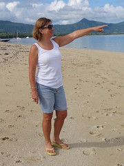 It's over there. (copperbottom1uk) Tags: woman feet beach point flipflops tanktop shorts pointing