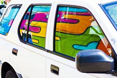 Mirrored Paint (Chris B Richmond) Tags: auto street urban white color reflection window girl car wall canon outside mirror rainbow automobile colorful paint pieces nashville outdoor tennessee vibrant double puzzle vehicle mirrored van dslr suv doubled