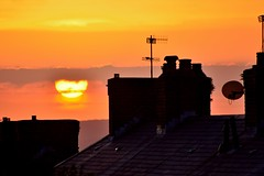 disks (doods-on on weekends) Tags: houses roof sunset red sky orange sun yellow gold colours chimneys satelite antenae