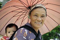 Woman with an umbrella carrying a baby on her back at the Quyt Tin market in H Giang Province - Vietnam (PascalBo) Tags: portrait people woman baby smile face umbrella outdoors kid nikon asia southeastasia vietnamese child market outdoor femme vietnam parasol asie ethnic minority enfant sourire march bb indigenous visage ethnicity headdress hilltribe parapluie headwear d300 vitnam ombrelle vitnam hagiang ethnie ethnicgroup asiedusudest hgiang quyettien pascalboegli quyttin