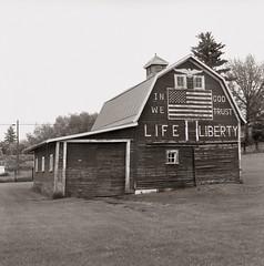 Latah N 1 (efo) Tags: bw film barn america painting liberty flag hasselblad signage washingtonstate latah ingodwetrust