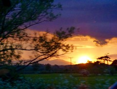 late evening (nannyjean35) Tags: trees sunset sky clouds hills fields posts
