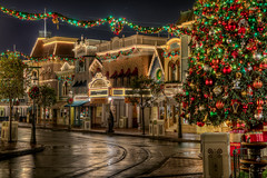 Rainy Winter Night (Justin in SD) Tags: christmas longexposure decorations holiday cinema tree bulb canon lights mainstreet disneyland garland disney resort christmaslights wreath anaheim hdr photomatix treedecorations canon60d