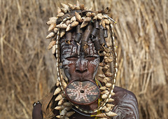 Mursi woman - Ethiopia (Eric Lafforgue) Tags: shells artistic culture tribal ornament clay tribes bodypainting tradition tribe ethnic rite bodymodification tribo labret adornment pigments ethnology tribu eastafrica thiopien etiopia ethiopie etiopa 3376  etiopija ethnie ethiopi  lipplug etiopien etipia  etiyopya  nomadicpeople         peoplesoftheomovalley lipdisclipplate piercedhole piercedlipornament