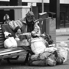 With all his belongings... (Akbar Simonse) Tags: street people urban bw man holland netherlands monochrome bench square zwartwit candid homeless streetphotography bank denhaag bin thehague streetshot straat litterbin hlb dakloos straatfotografie straatfoto straatfotograaf dedoka nederlandvandaag akbarsimonse hclb