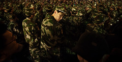 Chinese Soldier (Jonathan Kos-Read) Tags: china urban eye infantry night dark asian soldier army asia alone glare shanghai military chinese camo camouflage lonely  grainy   highiso redarmy goldenratio asiannight urbannight   chinesestreet streetcandid   chinesesoldier  headturn savedbythedeltemeuncensoredgrou aloneinacrowd singleeye communistsoldier nikond700 chineseface chinastreetphotography soldiersinformation