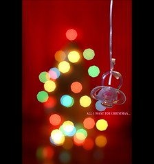 all i want for christmas is you... BABY! (*karla) Tags: christmas red baby colour tree canon 50mm lights dof bokeh merrychristmas