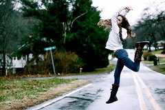 Jump for joy! ( NoelleBuske ) Tags: winter motion wet water girl rain happy fly dance jump jumping nikon focus boots action joy dancer jordan rainy raining d40 jumpforjoy