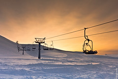 [Explored] -Skiing area in the Bláfjöll mountain range, south-west Iceland. (Gulli Vals) Tags: winter light sunset sky people orange sun white mountains ice clouds canon lens landscape photography iceland europe european colours skiing 05 freezing 01 freeze icecubes snowing lovely vals maountains 2012 gulli icelandic ljós litir fjöll fjallagarður