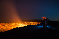 At the edge (Thierry Hennet) Tags: longexposure blue red people orange texture rock stone night zeiss landscape outdoors fire volcano lava photographer african sony crater ethiopia clearsky magma firelight a900 danakil ertaale cz1635mmf28