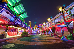 Walking on Streets of Tomorrow (TheTimeTheSpace) Tags: night stars lights nikon neon disney disneyworld rockets wdw waltdisneyworld tomorrowland magickingdom monstersinc stich d7000