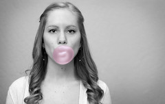 Bubble Pop (Brandilyn Photography) Tags: pink blackandwhite bw girl canon gum hair 50mm curly bubble curl bubblegum