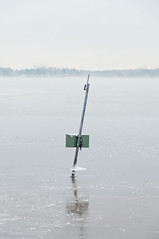 A Sign For Warmer Times (pni) Tags: winter sea sky ice nature sign metal suomi finland vinter helsinki quiet horizon pole environment helsingfors talvi seasmoke skrubu pni manandenvironment pekkanikrus arcticsteamfog