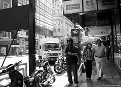 Hidden feelings / Sentimientos ocultos (Claudio.Ar) Tags: street city people bw woman men argentina bike buenosaires gente candid sony helmet ciudad motorbike moto casco dsc h9 motorcicles claudioar claudiomufarrege