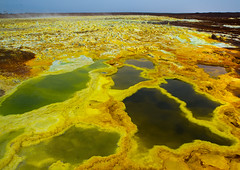 The colorful volcanic landscape of dallol in the danakil depression, Afar region, Dallol, Ethiopia (Eric Lafforgue) Tags: africa travel lake color green tourism nature pool beauty yellow horizontal landscape outdoors volcano spring colorful solitude day desert natural earth acid horizon surreal nobody nopeople formation serenity heat minerals environment sulphur isolation geography geology ethiopia hotspring volcanic saline geothermal interest arid ecosystem hornofafrica afar eastafrica geological abyssinia afarregion dallol danakildepression ethio161945