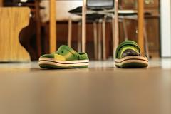 Feet in your Shoes (redaleka) Tags: wood light boy brazil man green feet kitchen metal brasil walking table chair focus shoes shiny floor legs bokeh walk flag ground tiles crocs